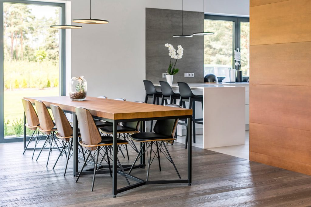 Wooden dining table in industrial style