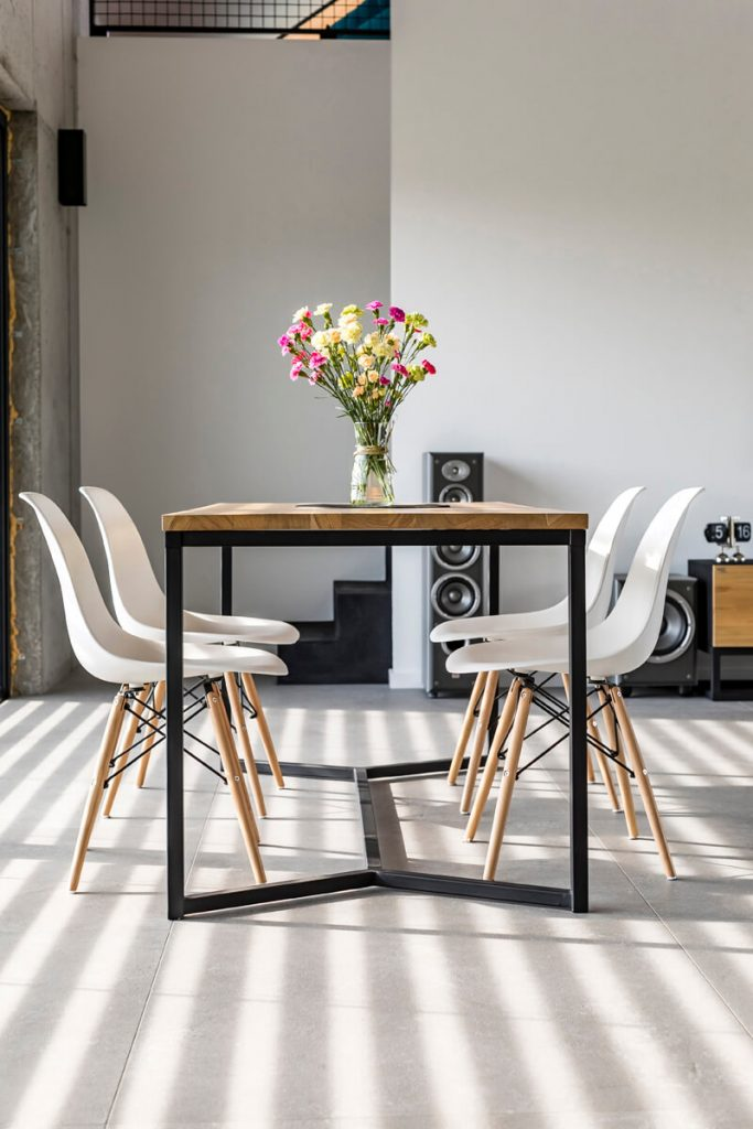 A wooden table on a metal base in industrial style from LOFT Decora