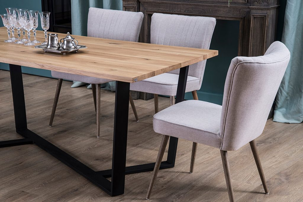 A wooden table on a steel base in the implementation of LOFT Decora