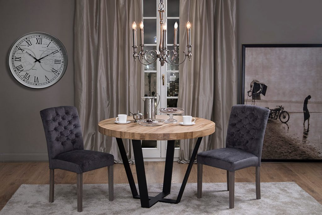 An industrial dining table on a black steel base