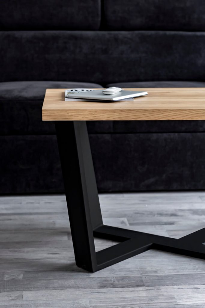 Table with a wooden table top on steel legs